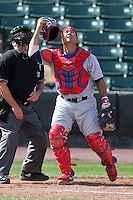Lehigh Valley Ironpigs catcher Dane Sardinha #22 in the field in front of umpire David Rackley during the second game of a double header against the Rochester Red Wings at Frontier Field on April 14, 2011 in Rochester, New York.  Lehigh Valley defeated Rochester 5-3 in extra innings.  Photo By Mike Janes/Four Seam Images