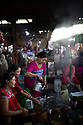 India - Manipur - Imphal - A street food stall serving traditional delicacies and tea. Female clients sit here ahd chit chat for hours while they do their grocery shopping and more. The Ima Market is a social gathering place for local women.
