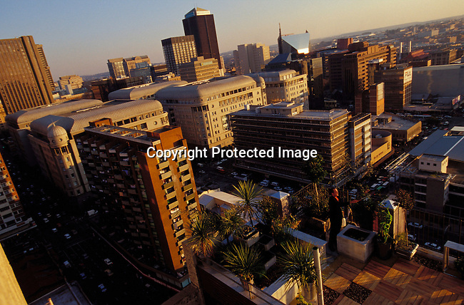 digajhb00179 .Gauteng. Johannesburg. Downtown. Landscape  view on the city. 2002. High rise buildings. People on rooftops, Rooftop gardens..©Per-Anders Pettersson/iAfrika Photos
