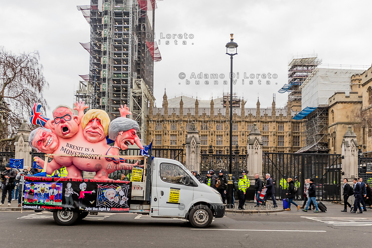 LONDON, ENGLAND - JANUARY 15: Caricatures of Conservative politicians are driven past the Houses of Parliament on January 15, 2019 in London, England. Theresa May's Brexit deal finally reaches the House of Commons this evening and MPs will begin voting on it at 7pm. The Prime Minister has consistently said her's is the only deal that Brussels will entertain and urged support from Parliament to avoid the UK crashing out of the European Union with no deal. Photo Adamo Di Loreto