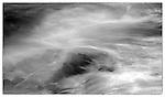 June 2016 - Snaefellsnes Peninsula, West Iceland -  Crashing waves along Skardsvik Beach's rocky coast and rising evening tide, Snaefellsnes Peninsula, West Iceland.