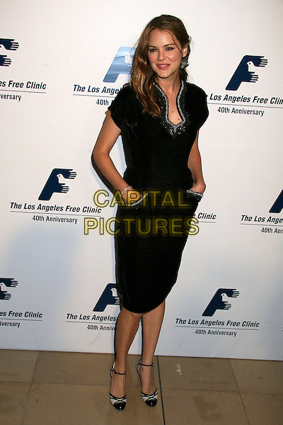 JACINDA BARRETT.Attends the Friends of the LA Free Clinic Annual Dinner Gala at The Beverly Hilton Hotel, Beverly Hills, California, USA, 20 November 2006..full length black dress hands in pockets.CAP/ADM/BP.©Byron Purvis/AdMedia/Capital Pictures.