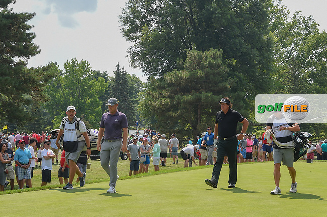 Tyrell Hatton (ENG) and Phil Mickelson (USA) head down 3 during 4th round of the World Golf Championships - Bridgestone Invitational, at the Firestone Country Club, Akron, Ohio. 8/5/2018.<br /> Picture: Golffile | Ken Murray<br /> <br /> <br /> All photo usage must carry mandatory copyright credit (© Golffile | Ken Murray)