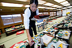 "Staffer Natsumi Takagi sets the tables in preparation for an evening aboard a ""Yakata-bune"" pleasure boat run by the Yasuda family in Tokyo, Japan on 31 August  2010. .Photographer: Robert Gilhooly"