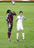 Action photo of Megan Rapinoe of United States and Fiorda Charles of Haiti. The US Women's National Team defeated Haiti 5-0 during the CONCACAF Women's World Cup Qualifying tournament at Estadio Quintana Roo in Cancun, Mexico on October 28th, 2010.