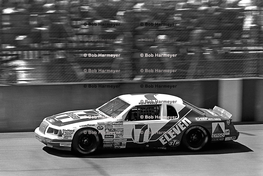 BROOKLYN, MI - AUGUST 11: Kyle Petty drives the Wood Brothers Ford during the Champion Spark Plug 400 NASCAR Winston Cup race at the Michigan International Speedway near Brooklyn, Michigan, on August 11, 1985.