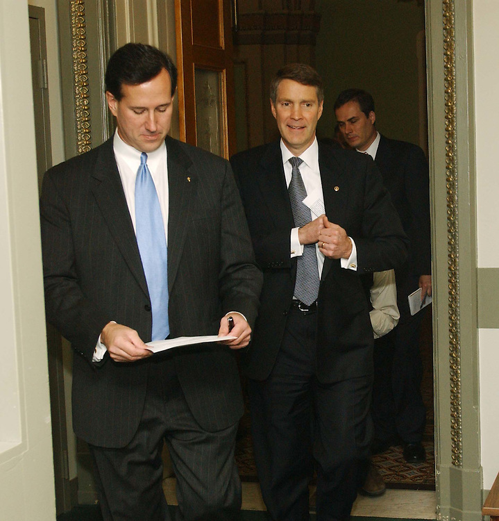 11/16/04.SENATE GOP LEADERSHIP--Conference Chairman Rick Santorum, R-Pa., and Majority Leader Bill Frist, R-Tenn, arrive for a news conference following the GOP conference election of the leaders. Dole won over Norm Coleman of Minnesota by a single vote, 28-27, in the only contested election. CONGRESSIONAL QUARTERLY PHOTO BY SCOTT J. FERRELL
