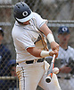 Chris Siklas #5, Oceanside first baseman, connects for a two-run double in the bottom of the fourth inning of a Nassau County varsity baseball game against Massapequa at Oceanside High School on Monday, April 24, 2017. The hit capped a five-run outburst that extended the Sailors' lead to 8-1. Oceanside survived a Massapequa rally in the seventh inning and held on to win by a score of 9-7.