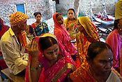 Pregnant woman share their experiences and discuss with each other in the delivery hut in Barwa village of East Champaran district of Bihar, India. Initiated to provide better pre-natal care to the pregnant women, Duncan Hospital with collaboration with Geneva Global has initiated a special campaign - delivery hut. Villagers here are told about various health issues, women go through free pre-natal check ups etc. Since 2008 the Foundation and Geneva Global have been investing in the training of medical staff to improve the lives of people living in 600+ villages in the region. The NGOs are delivering cost effective interventions to address treatment, care and prevention of diseases, disability and preventable deaths amongst infants, adolescent girls and women of child-bearing age. There is statistical and anecdotal evidence that there have been vast improvements and a total of 40-50% increased immunization for all children under 6 has meant that communities can be serviced and educated long term. Photograph: Sanjit Das/Panos for Legatum Foundation