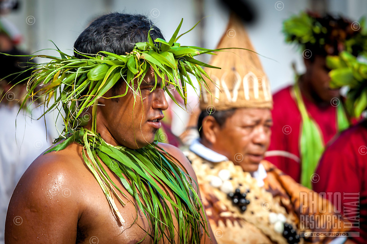 Men dressed in traditional attire at the investiture of Makirau Haurua with the Teurukura Ariki title, Aitutaki Island, Cook Islands.