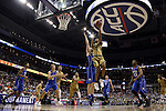 10 March 2016: Notre Dame's V.J. Beachem (3) shoots a layup over Duke's Marshall Plumlee. The University of Notre Dame Fighting Irish played the Duke University Blue Devils at the Verizon Center in Washington, DC in the Atlantic Coast Conference Men's Basketball Tournament quarterfinal and a 2015-16 NCAA Division I Men's Basketball game. Notre Dame won the game 84-79 in overtime.