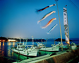 JAPAN, Kyushu, night shot of boats moored in Genkai harbor at night