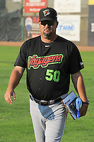 Great Falls Voyagers pitching coach Brian Drahman (50) walks onto the field as the Voyagers prepare to face Ogden Raptors at Lindquist Field on August 14, 2013 in Ogden Utah. (Stephen Smith/Four Seam Images)