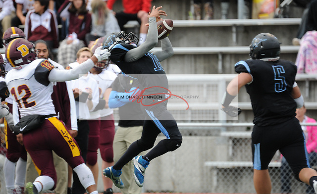 Chugiak's Ramal Maad intercepts  a pass as teammate Karlatty Faamatainu and a Dimond defender look on . Photo by Michael Dinneen for the Star.