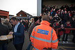 Fleetwood Town 1 Wrexham 1, 10/04/2012. Highbury Stadium, Football Conference Premier. A steward watching on as home supporters make their way into the Memorial Stand before Fleetwood Town hosted Wrexham in a Blue Square Conference Premier match at Highbury Stadium. The match, between the top two teams in the division ended in a 1-1 draw watched by a near-capacity crowd of 4996. A victory for the hosts would have seen the club promoted to the Football League for the first time. Photo by Colin McPherson.