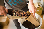 Brandon McGee, family owner of Bicycle Coffee Company, fills bags of medium roast arabica beans from the highlands of Peru. Bicycle Coffee Company is a San Francisco start-up taking green to a new level, by delivering hand-roasted coffee to over 100 local businesses, in addition to Whole Foods, by bicycle only, on Monday, April 4, 2011.  Lianne Milton for The Wall Street Journal.Bay Area - Coffee Status