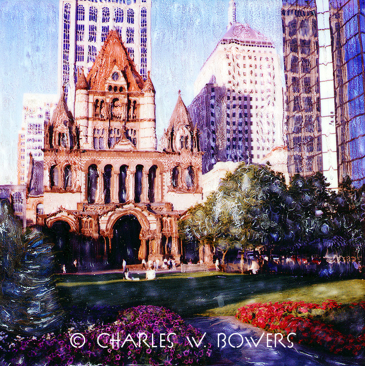 Warm sunlight fills Copley Plaza and highlights Trinity Church. People sit under the shade to enjoy the afternoon.<br />