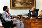 United States President George H.W. Bush meets with the Reverend Jesse Jackson in the President's Office in the White House Residence in Washington, D.C. on March 1, 1989.<br /> Mandatory Credit: Carol Powers / White House via CNP