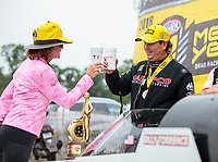 Aug 19, 2018; Brainerd, MN, USA; NHRA top fuel driver Billy Torrence (right) celebrates with wife Kay Torrence after winning the Lucas Oil Nationals at Brainerd International Raceway. Mandatory Credit: Mark J. Rebilas-USA TODAY Sports