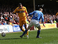 Chris Humphrey beats Steven Anderson in the Motherwell v St Johnstone Clydesdale Bank Scottish Premier League match played at Fir Park, Motherwell on 28.4.12.