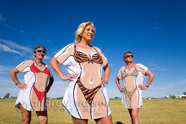 A group of women in novelty dress for the annual Birdsville Races.  Every September thousands of people arrive in the remote town of Birdsville, for the most famous horse racing carnival in outback Australia. Birdsville, Queensland, AUSTRALIA.