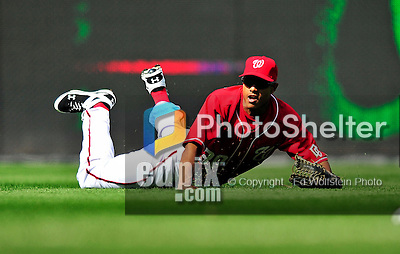 25 April 2010: Washington Nationals' outfielder Justin Maxwell pulls in a Ronnie Belliard fly ball in the top of the 9th inning of a game against the Los Angeles Dodgers at Nationals Park in Washington, DC. The Nationals shut out the Dodgers 1-0 to take the rubber match of their 3-game series. Mandatory Credit: Ed Wolfstein Photo