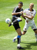 20 June 2009: Pablo Campos of the Earthquakes controls the ball away from Gregg Berhalter of the Galaxy during the game at Oakland-Alameda County Coliseum in Oakland, California.   Earthquakes defeated Galaxy at 2-1.