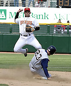 April 10, 2004:  Luis Rodriguez (2) of the Rochester Red Wings, Triple-A International League affiliate of the Minnesota Twins, leaps over Gabe Gross during a game at Frontier Field in Rochester, NY.  Photo by:  Mike Janes/Four Seam Images
