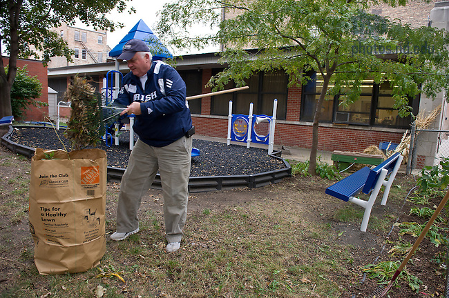 Oct. 5, 2012; Mike Ruffer '73 cleans up the grounds at Saint Ann's Catholic School in Chicago as part of the Alumni Association service project...Photo by Matt Cashore/University of Notre Dame
