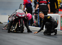 Sept. 16, 2011; Concord, NC, USA: NHRA pro stock motorcycle rider Matt Smith (right) checks the track for wife Angie Smith during qualifying for the O'Reilly Auto Parts Nationals at zMax Dragway. Mandatory Credit: Mark J. Rebilas-US PRESSWIRE