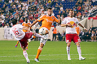 Will Bruin (12) of the Houston Dynamo and Connor Lade (16) of the New York Red Bulls go for the ball. The New York Red Bulls defeated the Houston Dynamo 1-0 during a Major League Soccer (MLS) match at Red Bull Arena in Harrison, NJ, on May 09, 2012.