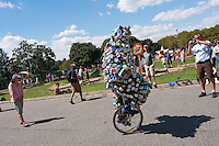 Governor's  Island, NY -  4 September 2010 - Gene Pool, also known as The Can Man, wearing his aluminum can suit and riding his unicycle during the New York City Unicycle Festival on Governor's Island. The Island which is located in New York Harbor, between Manhattan and Brooklyn, was one of the most popular places for New Yorkers to spend the say.