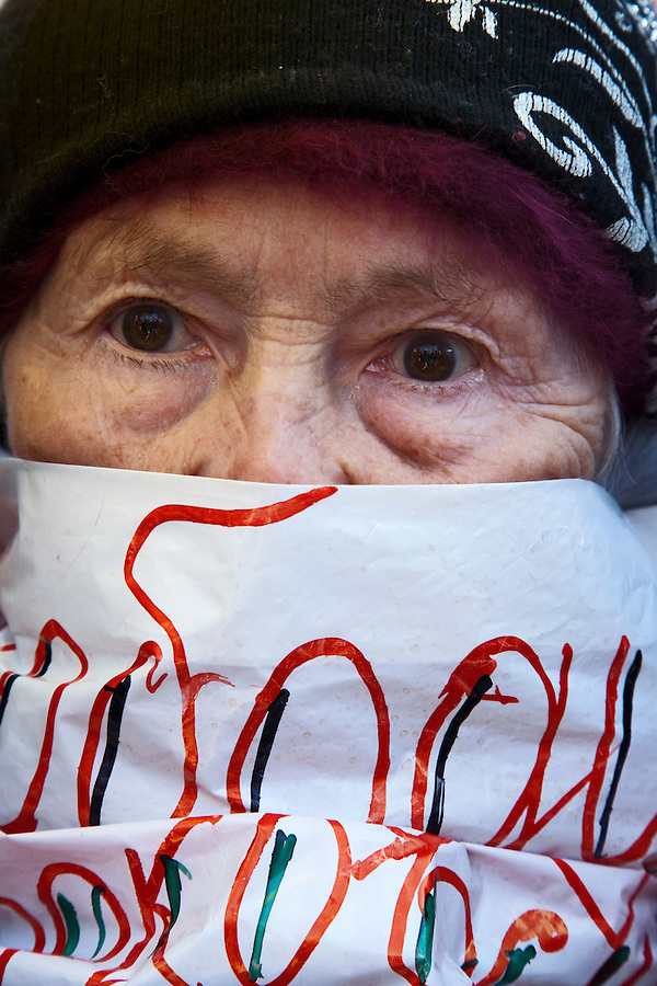 Moscow, Russia, 10/03/2012..An 80 year old woman covers her face with slogans as up to 20,000 people protest in central Moscow against Vladimir Putin's victory in the Russian presidential election.