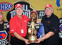Jul, 22, 2012; Morrison, CO, USA: NHRA top fuel dragster driver Antron Brown celebrates with crew after winning the Mile High Nationals at Bandimere Speedway. Mandatory Credit: Mark J. Rebilas-