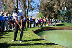 Alvaro Quiros (ESP) chips his penalty drop shot onto the 3rd green after driving through and into the water during the Final Day Sunday of the Open de Andalucia de Golf at Parador Golf Club Malaga 27th March 2011. (Photo Eoin Clarke/Golffile 2011)