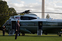 US President Donald J. Trump walks to board Marine One after stopping to deliver remarks to the news media on the South Lawn of the White House in Washington, DC, USA, 07 October 2017. President Trump is traveling to  North Carolina for a pair of fund raising events<br /> CAP/MPI/POOL/ST<br /> &copy;ST/POOL/MPI/Capital Pictures