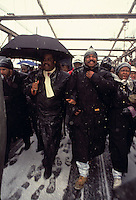 (910118-SWR01) -- New York, NY -- 18JAN-91 -- Thhe Reverend Al Sharpton and Moses Stewart march across the Brooklyn Bridge, in the snow, on the birthday of Dr Martin Luther King © Stacy Walsh Rosenstock.