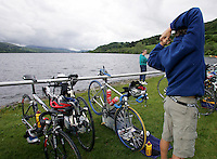 05 JUN 2005 - BALA, NORTH WALES, UK - A competitor stretches in transition before the start of the British Middle Distance Triathlon Championships. (PHOTO (C) NIGEL FARROW)