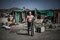 Fisherman German Poblete pose in Castilla, Chile, September 2012...Photo by Roberto Candia