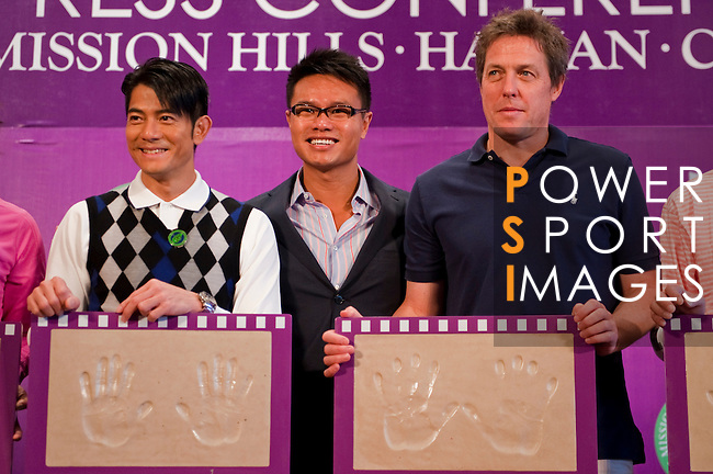 HAIKOU, CHINA - OCTOBER 28:  Hollywood actor Hugh Grant (R) of Great Britain and Hong Kong singer Aaron Kwok (L) pose with their handprints near Dr. Ken Chu (L), Vice Chairman of Mission Hills Group and during a press conference as part of the Mission Hills Star Trophy on October 28, 2010 in Haikou, China. The Mission Hills Star Trophy is Asia's leading leisure liflestyle event and features Hollywood celebrities and international golf stars. Photo by Victor Fraile / The Power of Sport Images