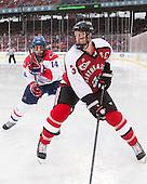Joseph Pendenza (UML - 14), Josh Manson (NU - 3) - The Northeastern University Huskies defeated the University of Massachusetts Lowell River Hawks 4-1 (EN) on Saturday, January 11, 2014, at Fenway Park in Boston, Massachusetts.