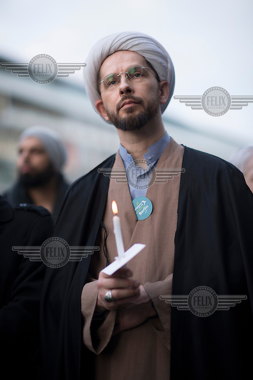 A Muslim cleric from the Dar-Assalam Mosque in Neukoelln during a peace rally with the slogan 'Religionen fuer ein weltoffenes Berlin' (Religions for a an open Berlin). It was held in memory of the victims of the Breitscheidtplatz Christmas market terror attack.