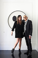 Ronnie and Vidal Sassoon infront of an artwork by Gerhart von Graevenitz in the living room of their London apartment