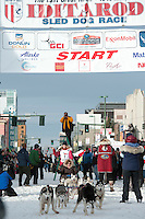 Lisbet Norris and team leave the ceremonial start line with an Iditarider at 4th Avenue and D Street in downtown Anchorage, Alaska on Saturday, March 5th during the 2016 Iditarod race. Photo by Joshua Borough/SchultzPhoto.com
