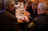 Senator Scott Brown (R-MA) speaks with actor Lenny Clarke (left) and Milford Chief of Police Thomas O'Loughlin at a meeting of the Law Enforcement Coalition for Brown at Johnny Jack's Restaurant in Milford, Massachusetts, USA, on Thurs., Nov. 2, 2012. Senator Scott Brown is seeking re-election to the Senate.  His opponent is Elizabeth Warren, a democrat.