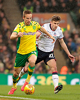 Norwich City's Marco Stiepermann is chased down by Bolton Wanderers Joe Williams<br /> <br /> Photographer David Shipman/CameraSport<br /> <br /> The EFL Sky Bet Championship - Norwich City v Bolton Wanderers - Saturday 8th December 2018 - Carrow Road - Norwich<br /> <br /> World Copyright &copy; 2018 CameraSport. All rights reserved. 43 Linden Ave. Countesthorpe. Leicester. England. LE8 5PG - Tel: +44 (0) 116 277 4147 - admin@camerasport.com - www.camerasport.com