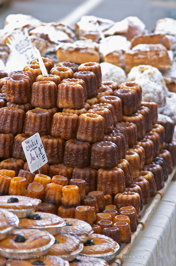 On a street market. Caneles cakes. Bordeaux city, Aquitaine, Gironde, France