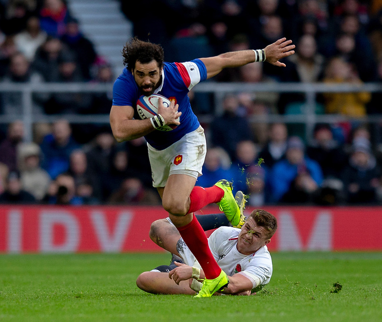 France's Yoann Huget evades the tackle of England's Henry Slade<br /> <br /> Photographer Bob Bradford/CameraSport<br /> <br /> Guinness Six Nations Championship - England v France - Sunday 10th February 2019 - Twickenham Stadium - London<br /> <br /> World Copyright © 2019 CameraSport. All rights reserved. 43 Linden Ave. Countesthorpe. Leicester. England. LE8 5PG - Tel: +44 (0) 116 277 4147 - admin@camerasport.com - www.camerasport.com
