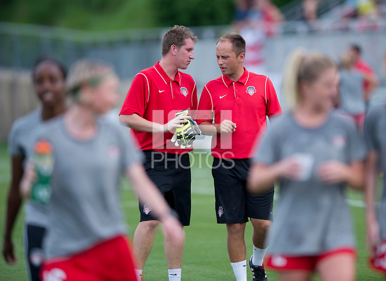 Washington Spirit head coach Mark Parsons (right) talks to goalkeeper coach Lloyd Yaxley before the game at the Maryland SoccerPlex in Boyds, MD. The Washington Spirit tied FC Kansas City, 1-1.