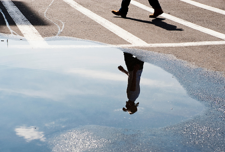 UNITED STATES - JULY 19: A tourist walks past a large rain puddle Union Station on Monday morning, July 19, 2010. Heavy thunderstorms Sunday night caused scattered power outages around the DC metro area. (Photo By Bill Clark/Roll Call via Getty Images)